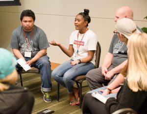 Ashanti Ilek (center) responds to a question.
