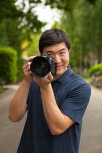 Chris Yang takes a photo with his camera