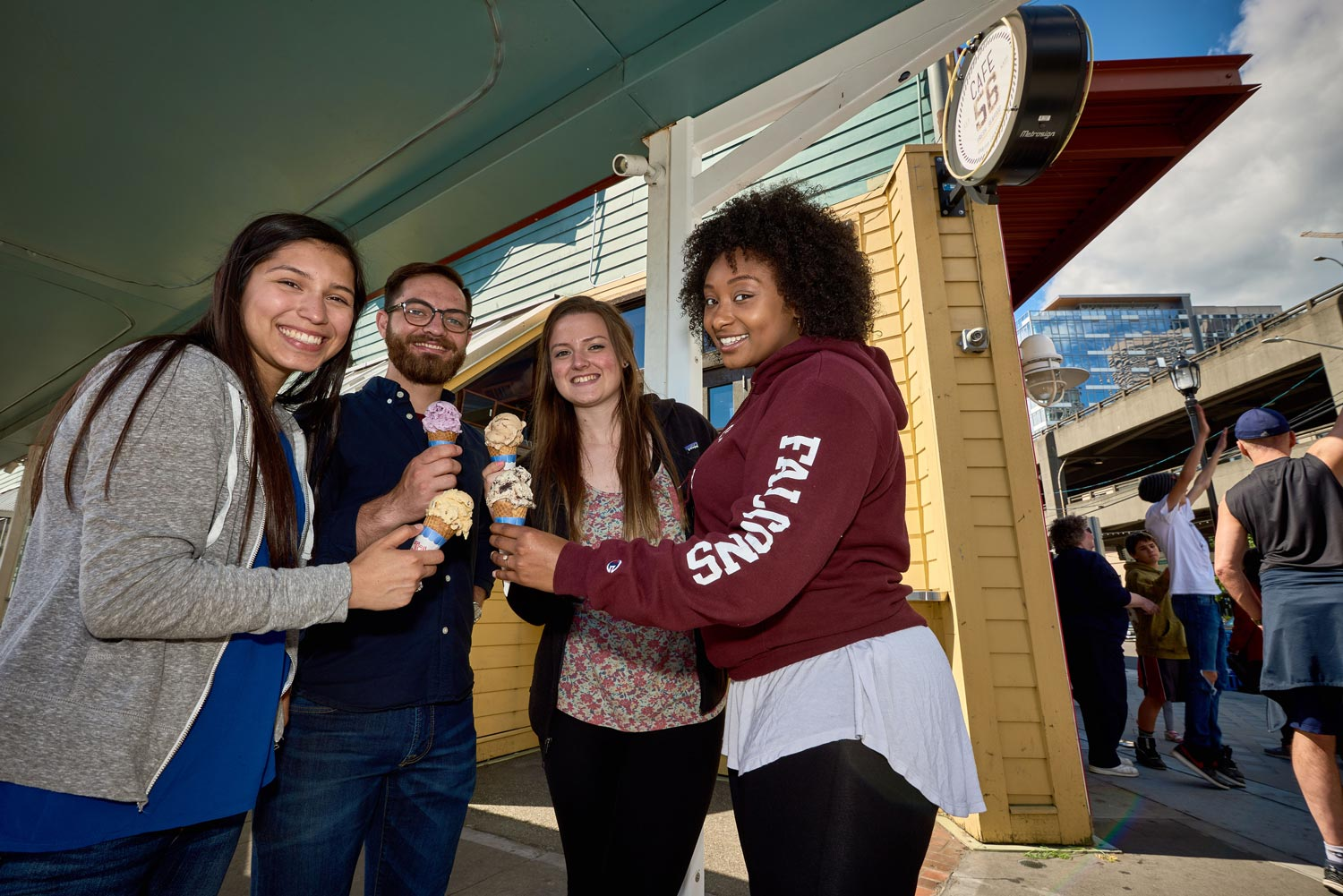 four students pose for picture at Cafe 56 ice cream shop