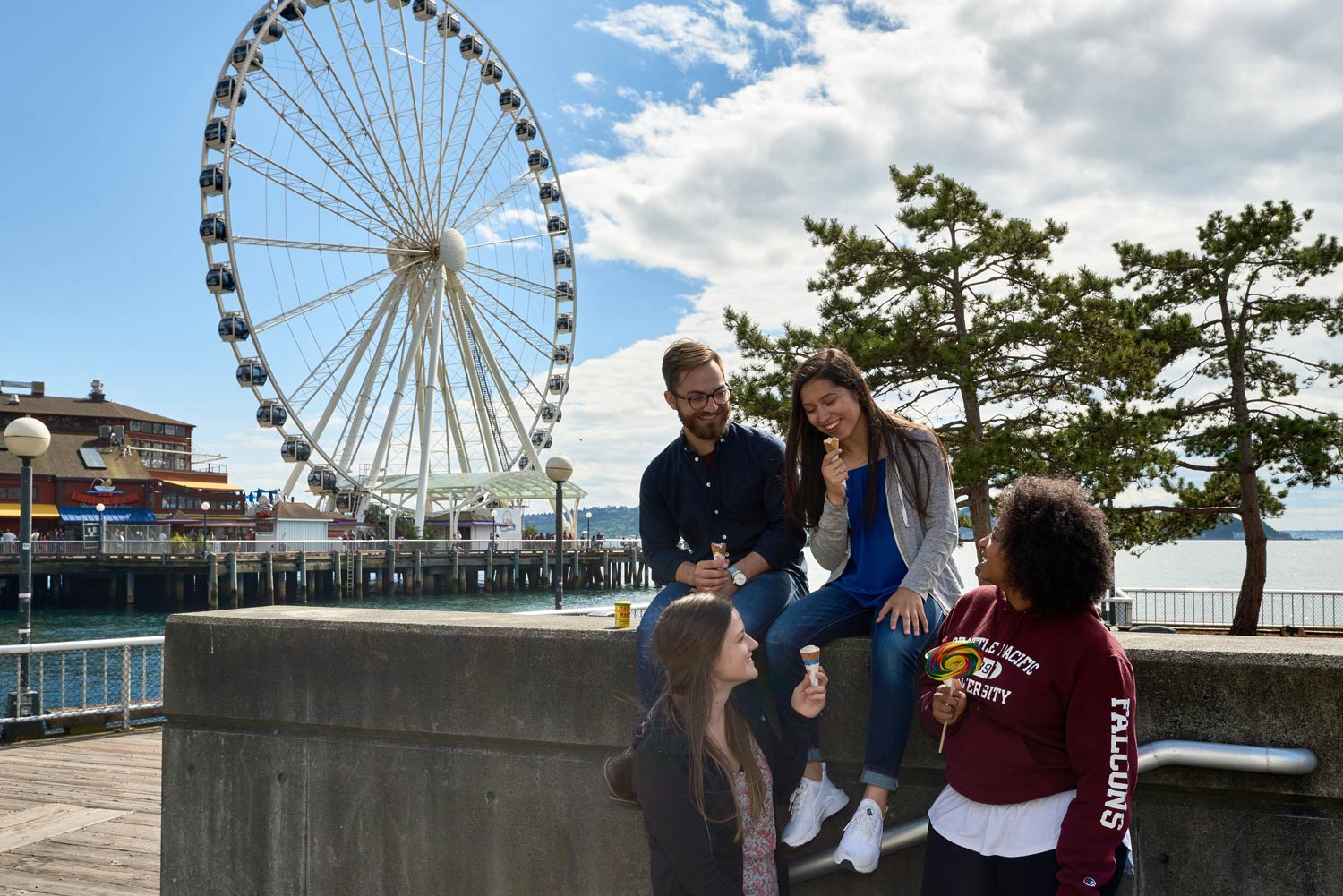 students enjoy dessert near the Seattle Great Wheel