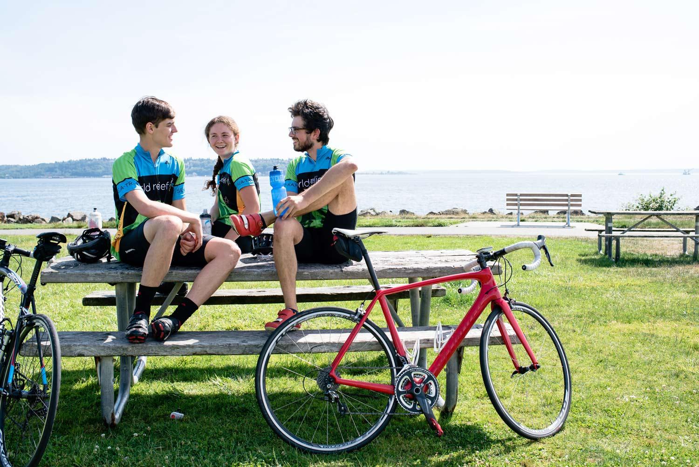Garrett, Kelsey, and Barrett sitting on a park bench