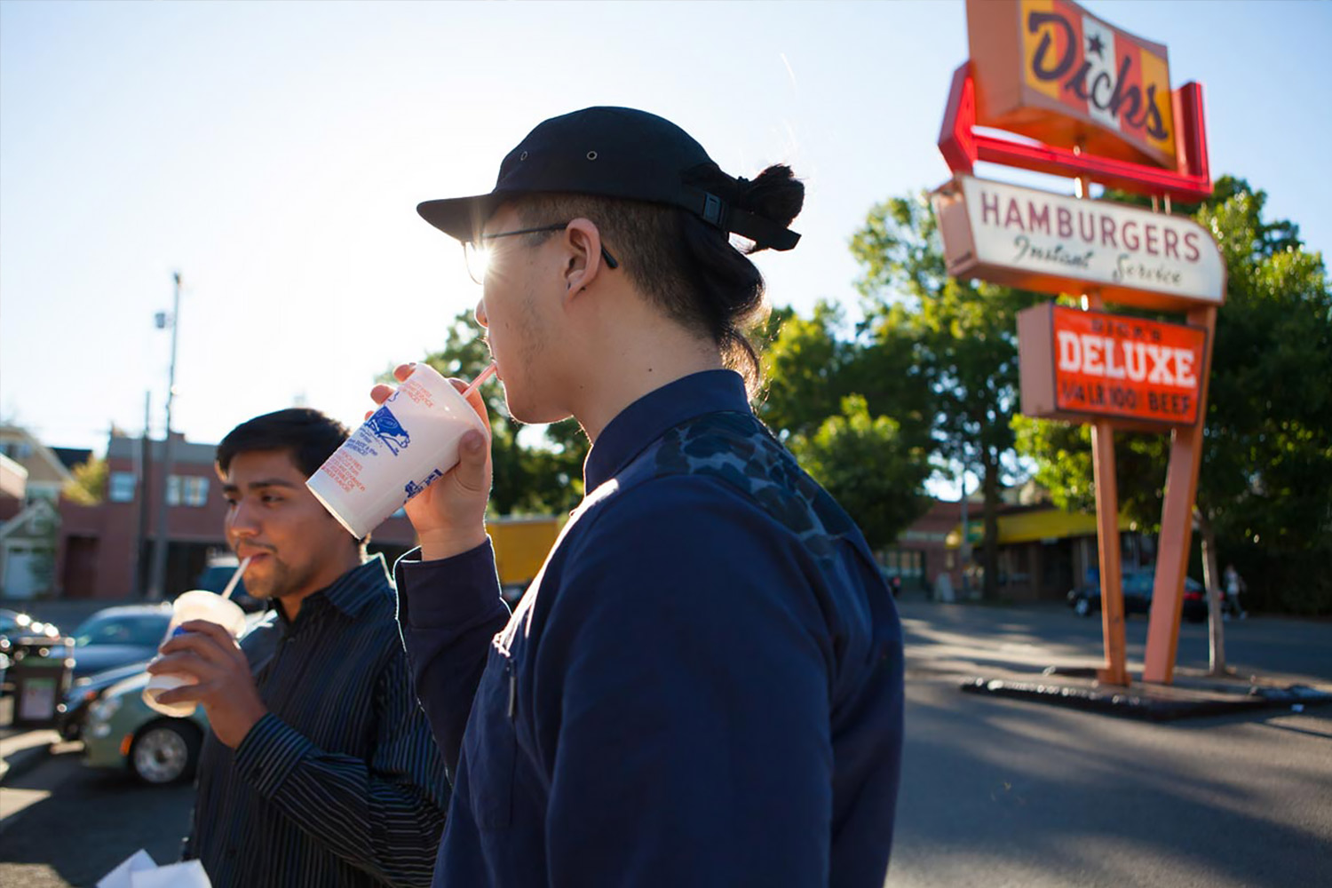 Students drinking milkshakes outside of Dick's Drive-In