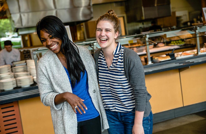 Maya Swinehart and Lauren Isham laughing in Gwinn Commons