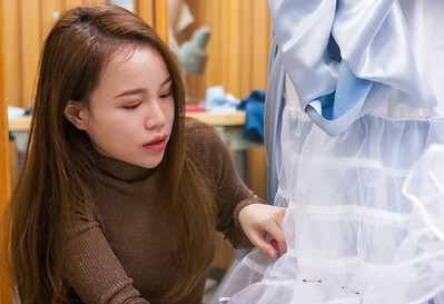 Syl Xu works on dress fitting