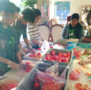 SPU students prepare food for the Hawaii club lu'au
