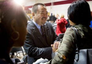 Reverend Soong-chan Rah greets a woman