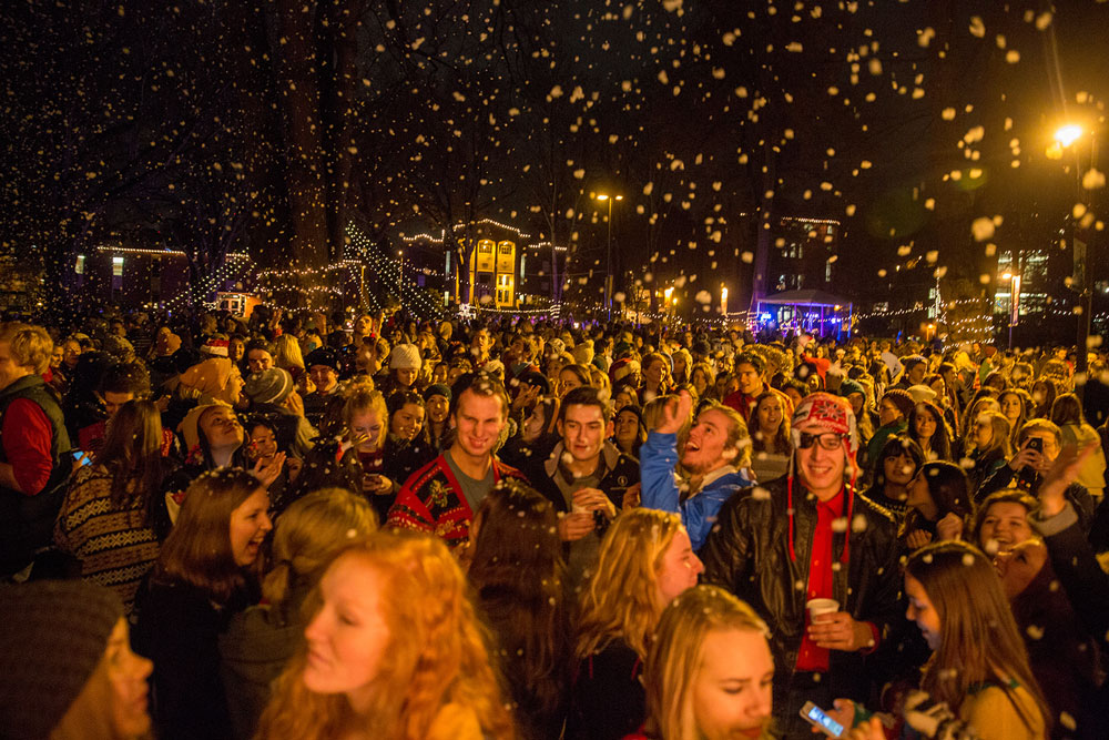 crowd of students under Christmas lights