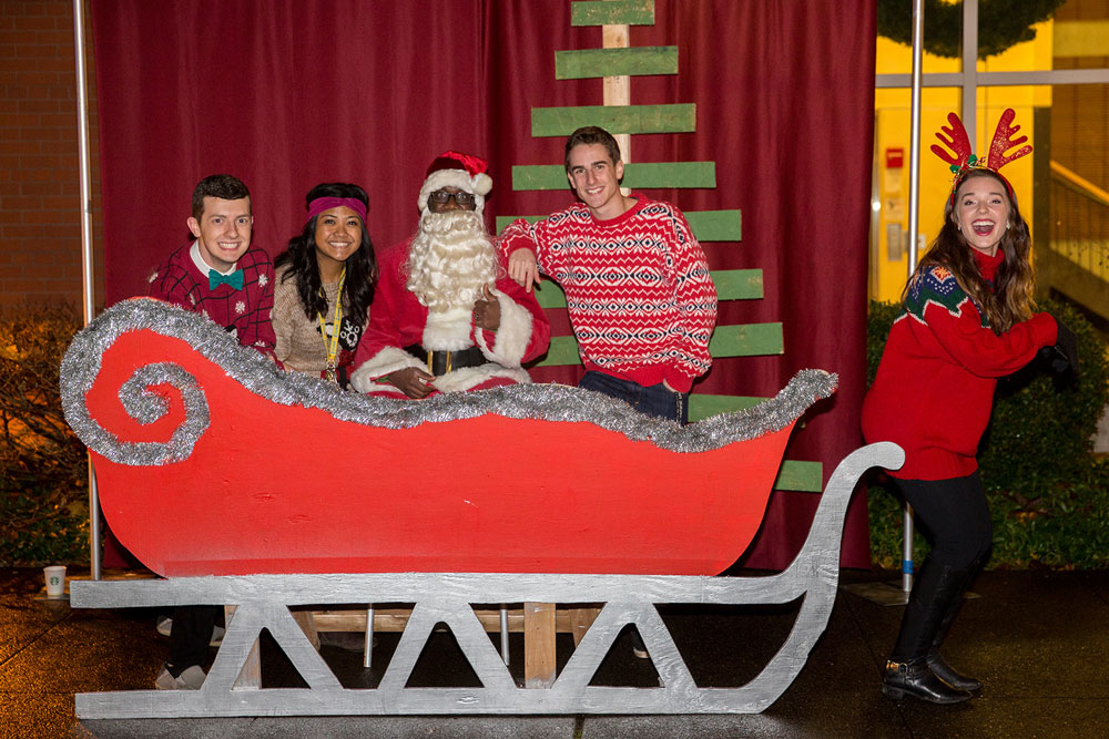 students take pictures with Santa