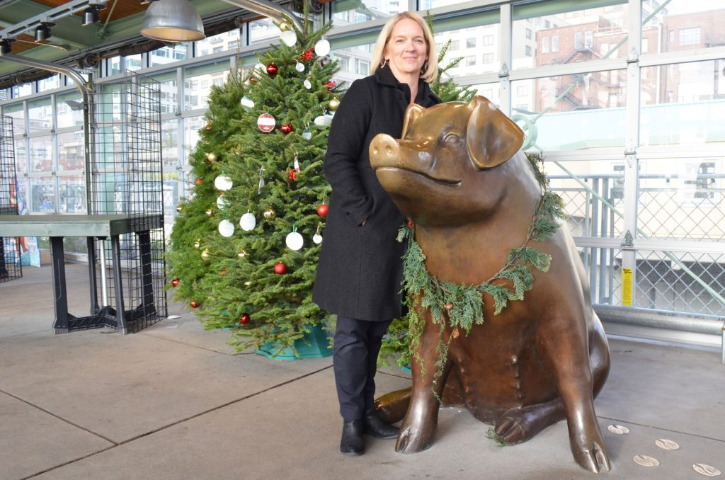 Lillian Sherman poses with the Pike Place pig