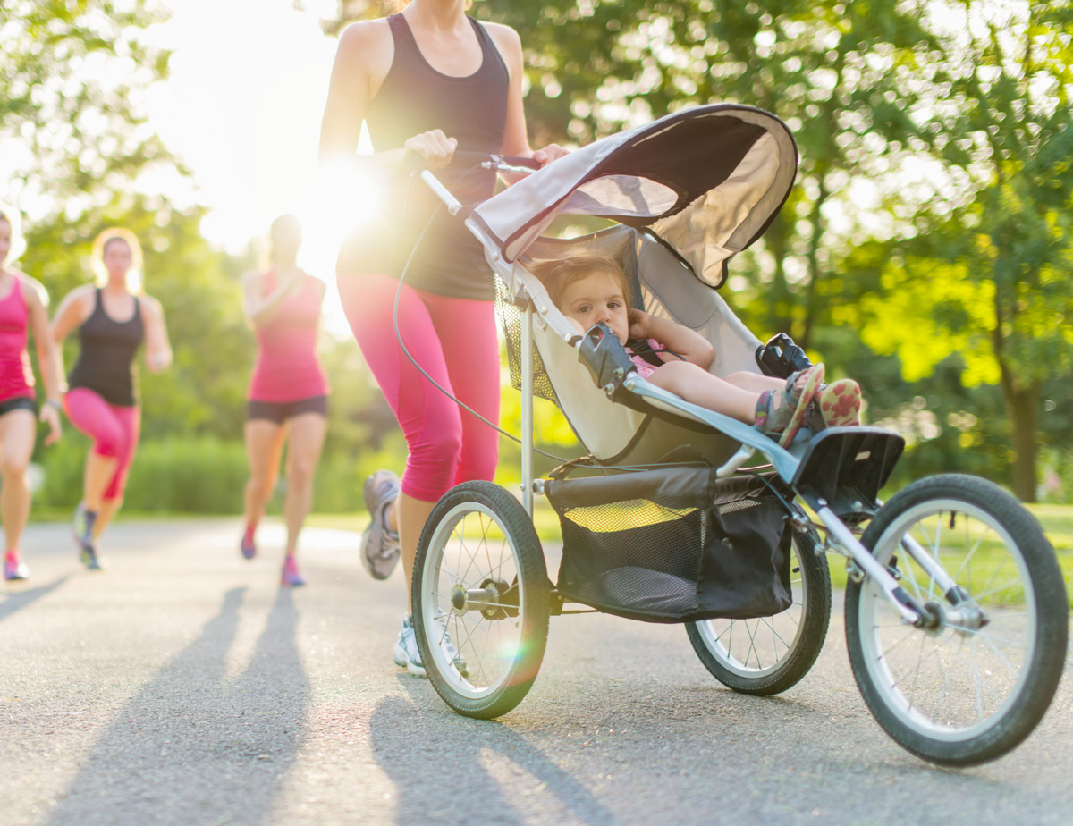 A mom jogging with her child.