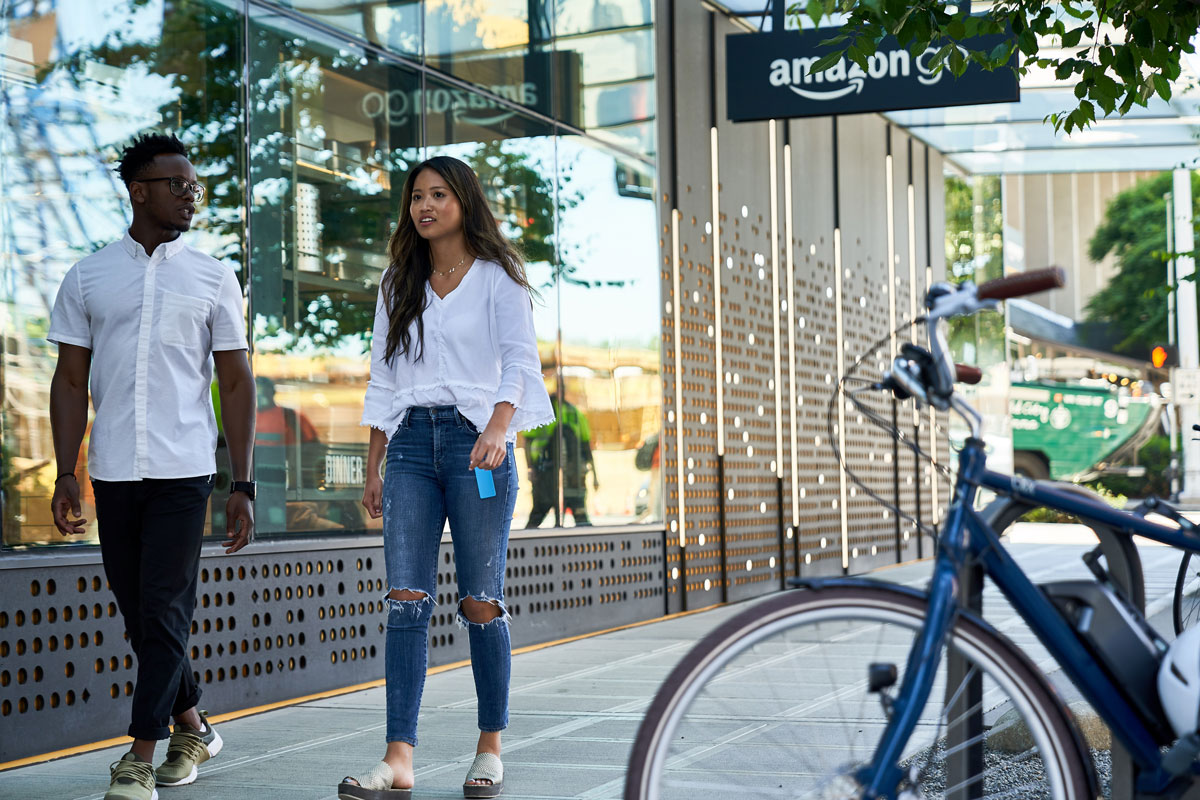 Praew Hemrathiran walks past the Amazon Go store