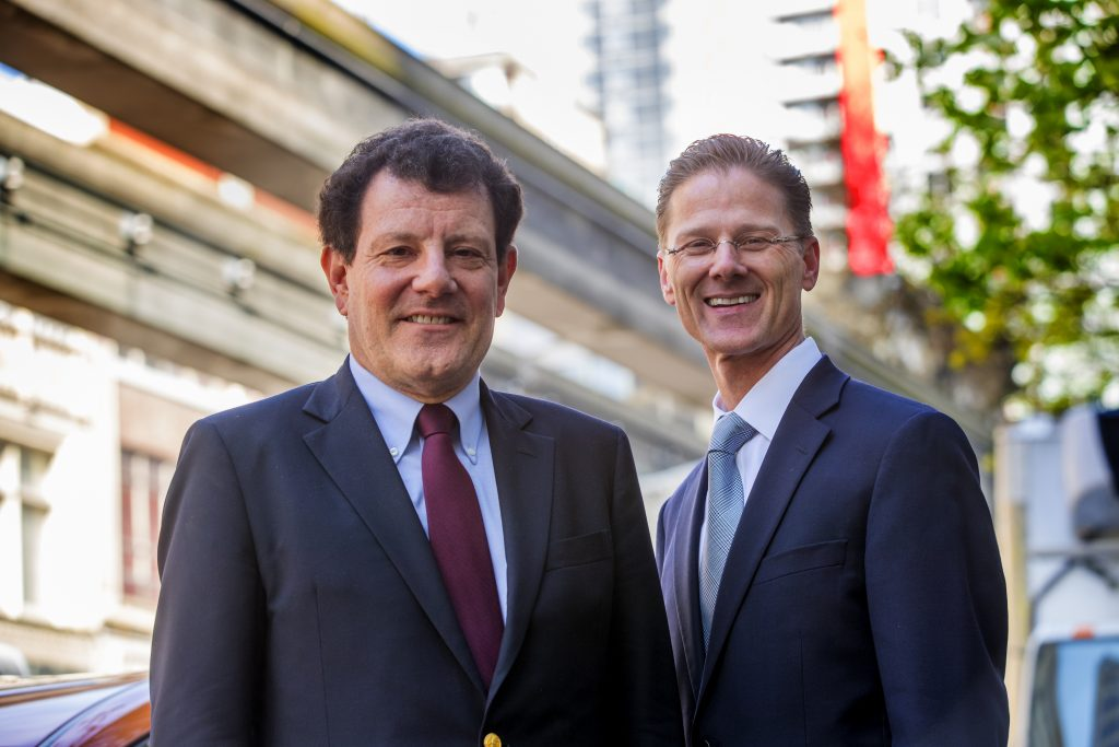 Nicholas Kristof and SPU President Daniel J. Martin stand in downtown Seattle