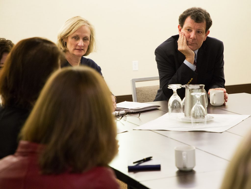 Kristof talks with a small group of women who are corporate leaders in the Seattle area