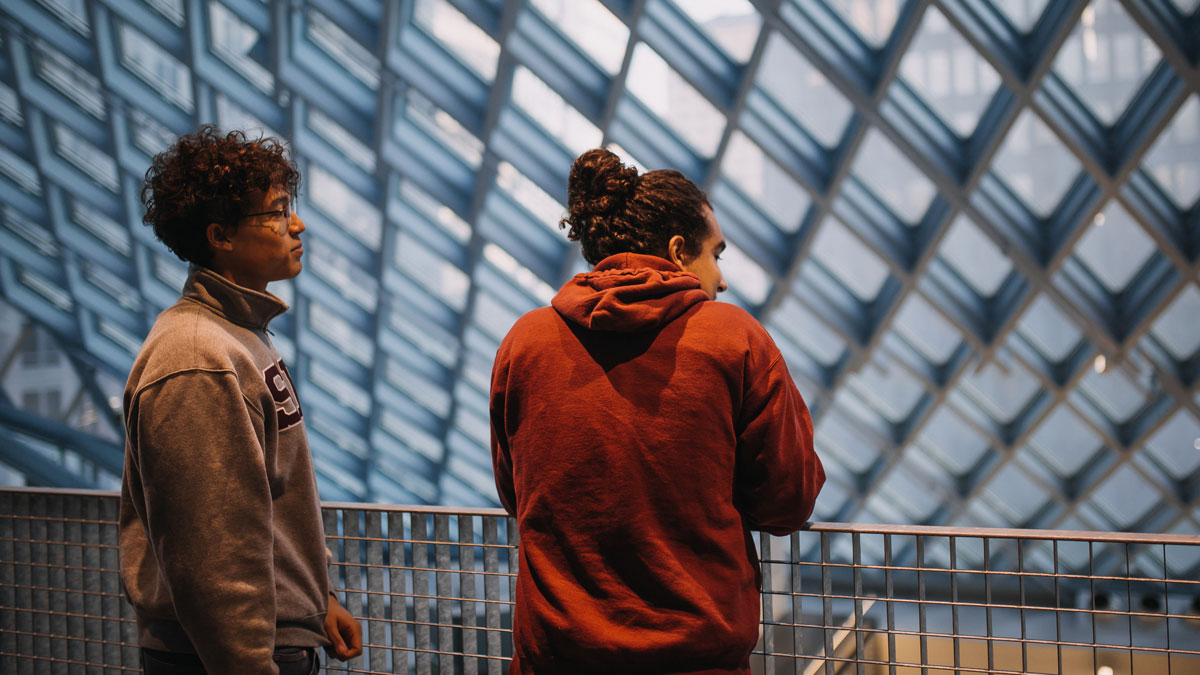 students looking through the seattle library glass windows