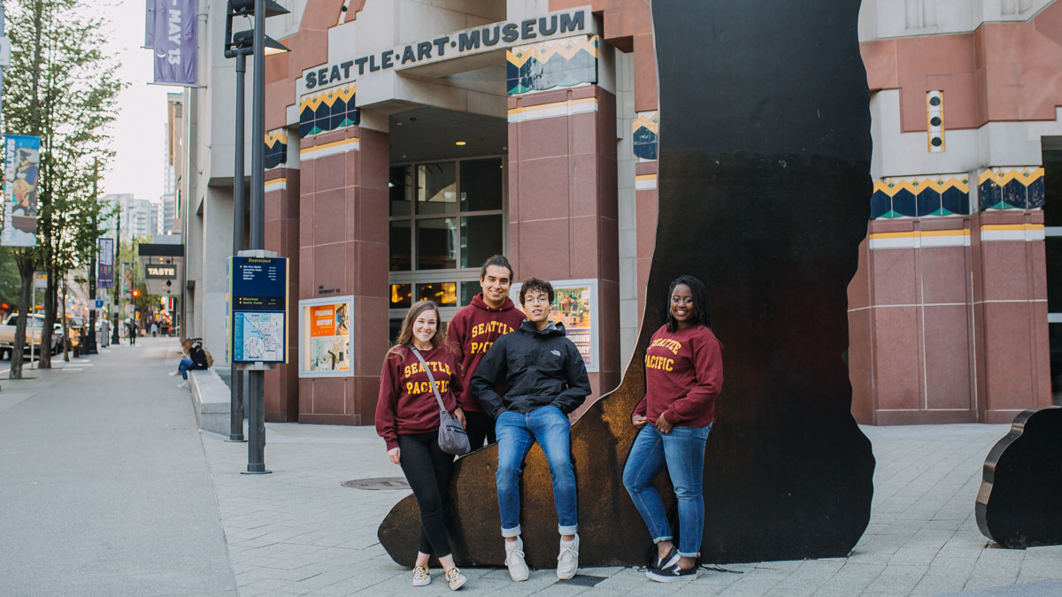 students pose in front of Seattle Art Museum