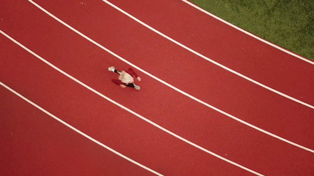 aerial view of doris running on track field