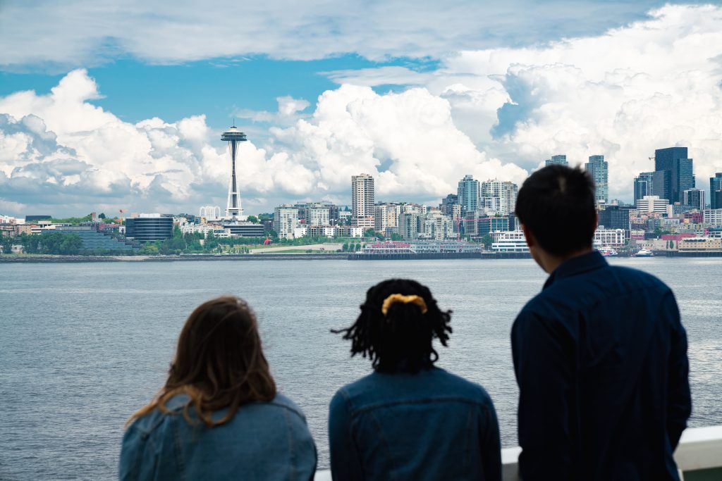 students looking to space needle in the distance