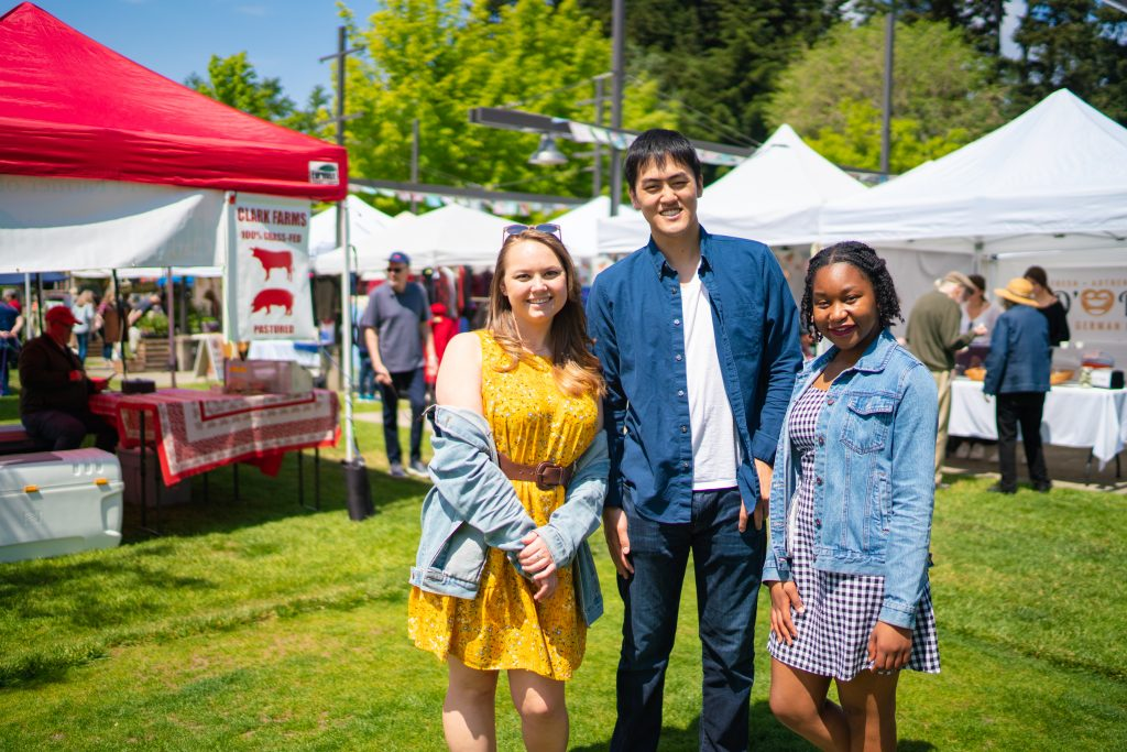 students pose at the farmers market