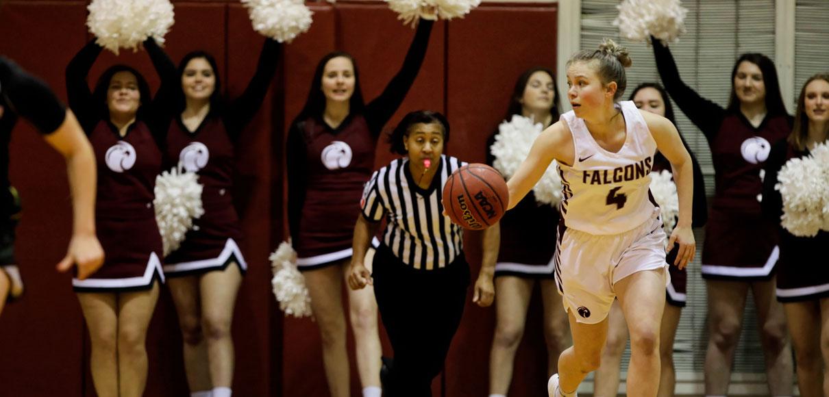spu woman basketball player dribbles down court