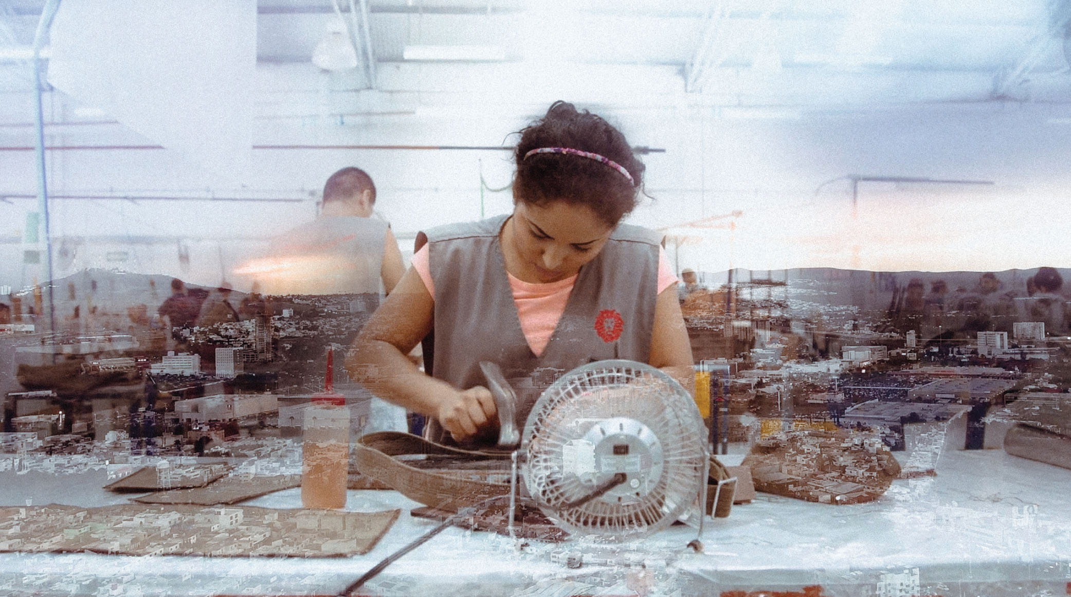 A woman works on a leather project