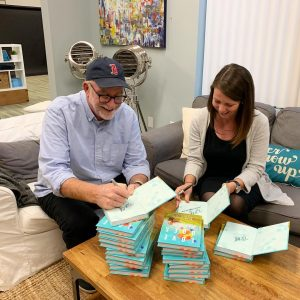 lindsey and her dad sign books