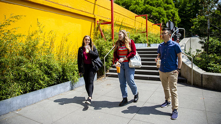 SPU students walk down the sidewalk in Seattle's International District - photo by Lindsey Wasson