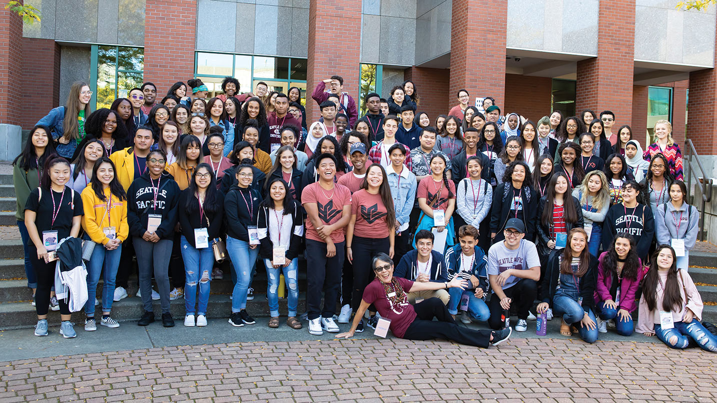 Susan Okamoto Lane, front center, welcomes the 2018 Early Connections students to SPU.