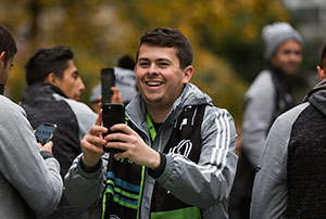 Danny Ciaccio shoots footage on his phone at a Sounders game | photo by Mike Fiechtner