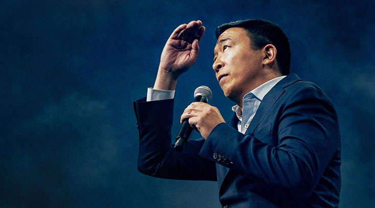 Andrew Yang faces the crowd at a rally