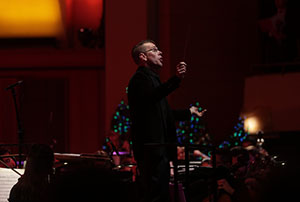 Danny Helseth conducts during the 2018 Sacred Sounds of Christmas concert | photo by Mike Siegel