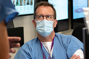 Dr. Steven Mitchell, emergency department director and regional COVID-19 response director, at Harborview Medical Center, discusses patient treatment options with a colleague in Seattle, Washington, on May 12, 2020.