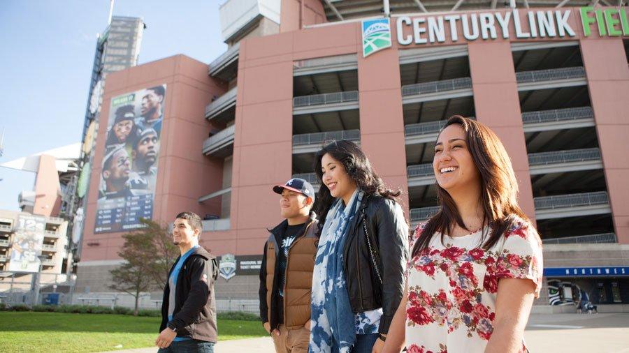 students walking by seahawks stadium