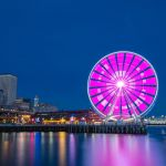 "Seattle's Great Wheel flashes ""SPU 125"" in Morse code."