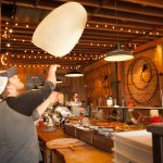 Chef tossing pizza at the Ballard Pizza Company