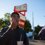 SPU student enjoying food at Dick's Drive-In