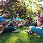 SPU students playing guitar, photo by Chris Yang