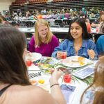 Eating and talking at the Hawaii club luau