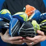 Ryan Alcantara '15 holds several pairs of running shoes.