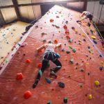SPU student rock climbing