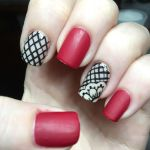 black and red patterned nail polish design